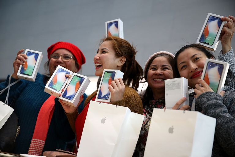 women with new iphones