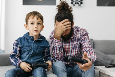 Father and Son Trying to Game