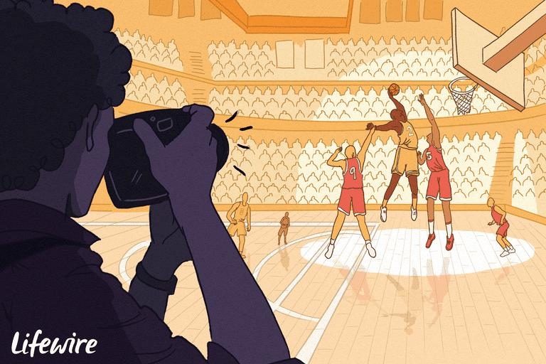 Photographer shooting a basketball game