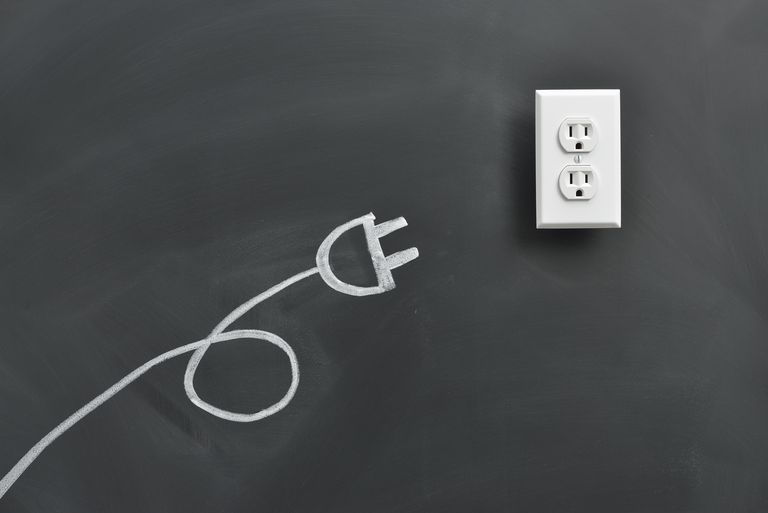 Plug drawing on the blackboard with an outlet