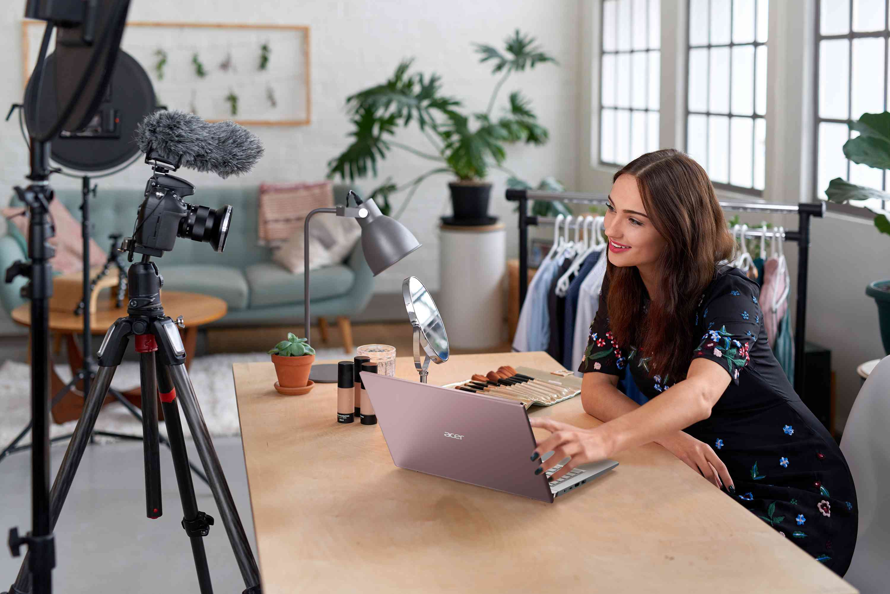 Woman filming herself while using the Acer Swift X