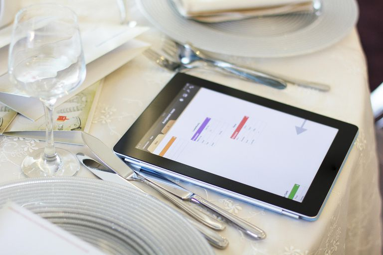 iPad tablet set on a formal dining table