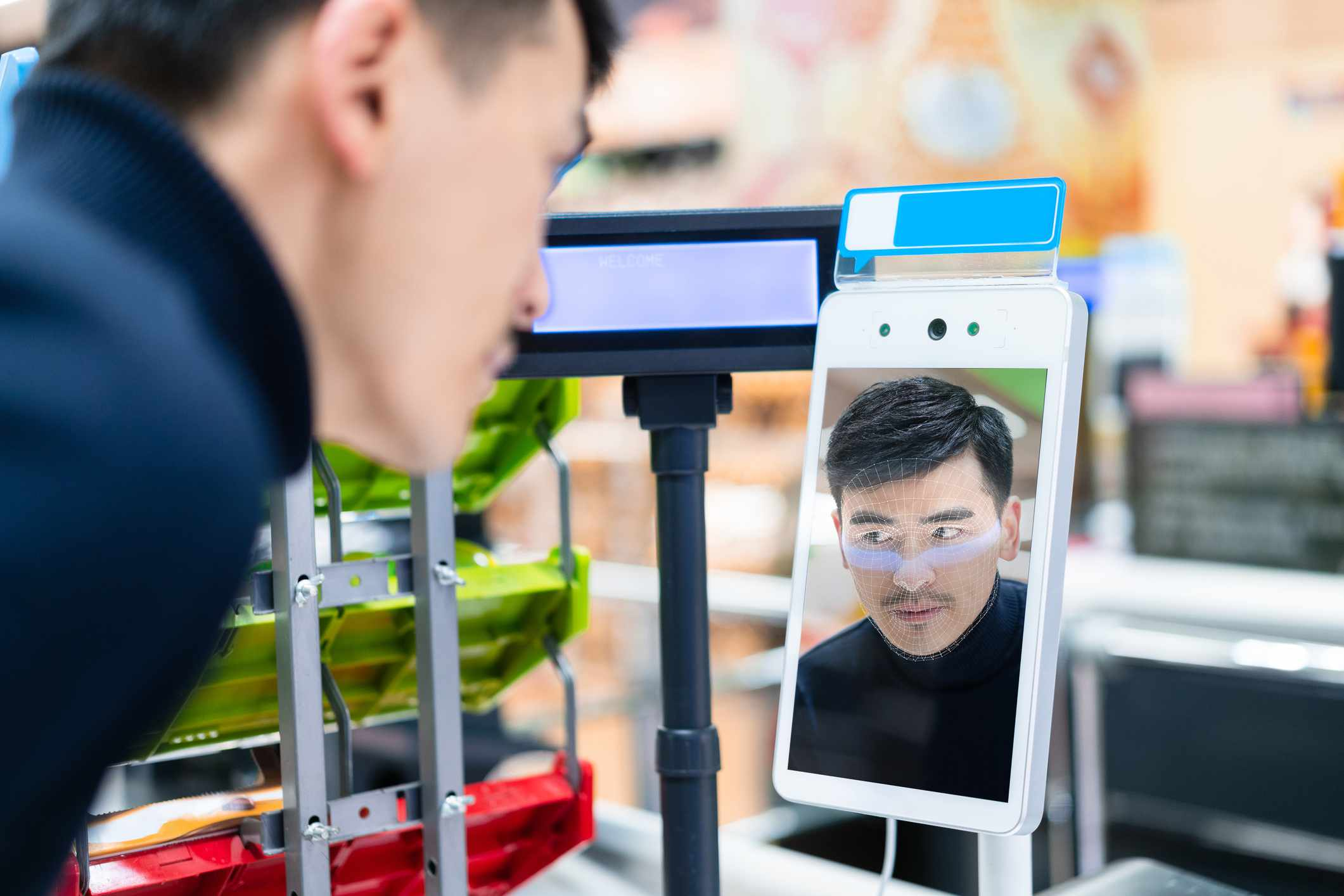 Someone using facial recognition for a contactless payment.