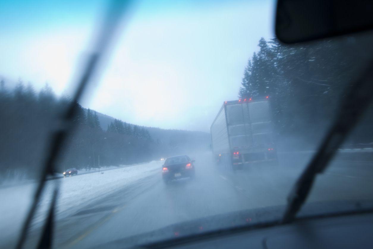 A foggy windshield in a car.