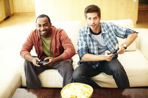 Two buddies playing video games.
