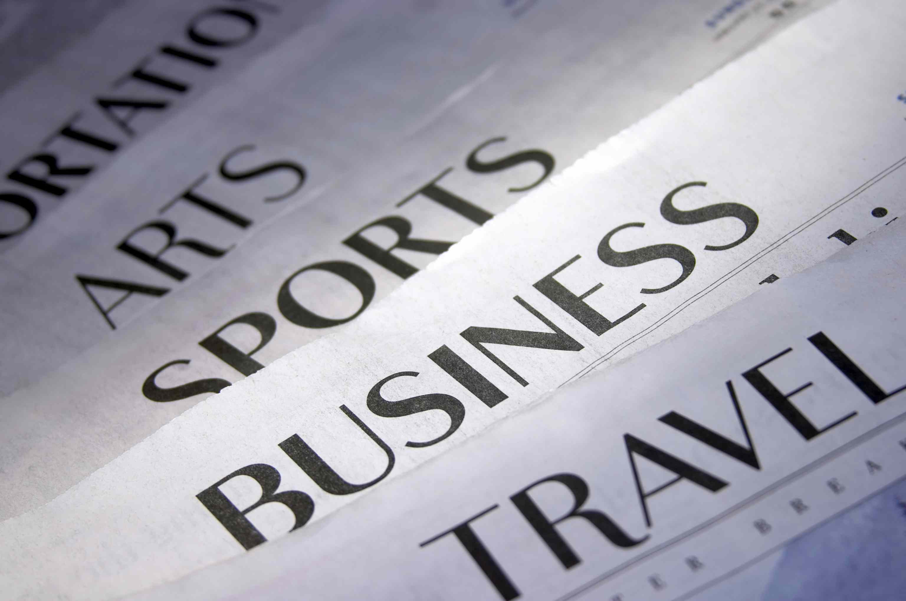 newspaper headlines.