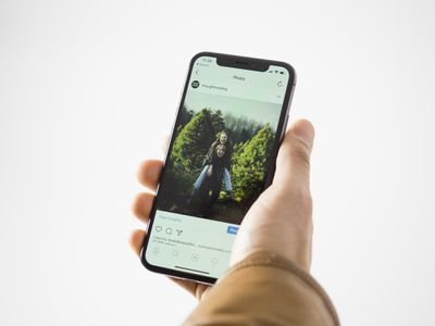 An image of a person looking at an Instagram photo post on a smartphone.