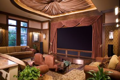 Living room designed with the look and feel of a plush movie theater