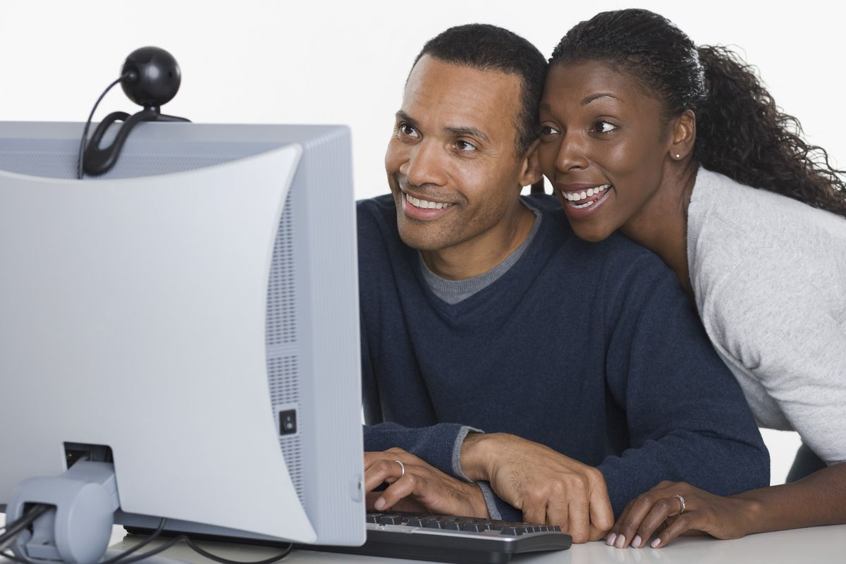 Couple using a webcam on a computer