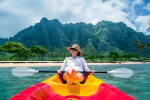 Traveler relaxing in kayak in tropical area on vacation