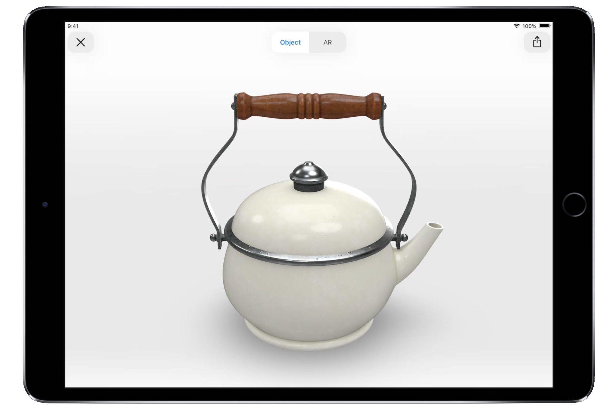 iPad showing an AR object of a teapot on an iPad