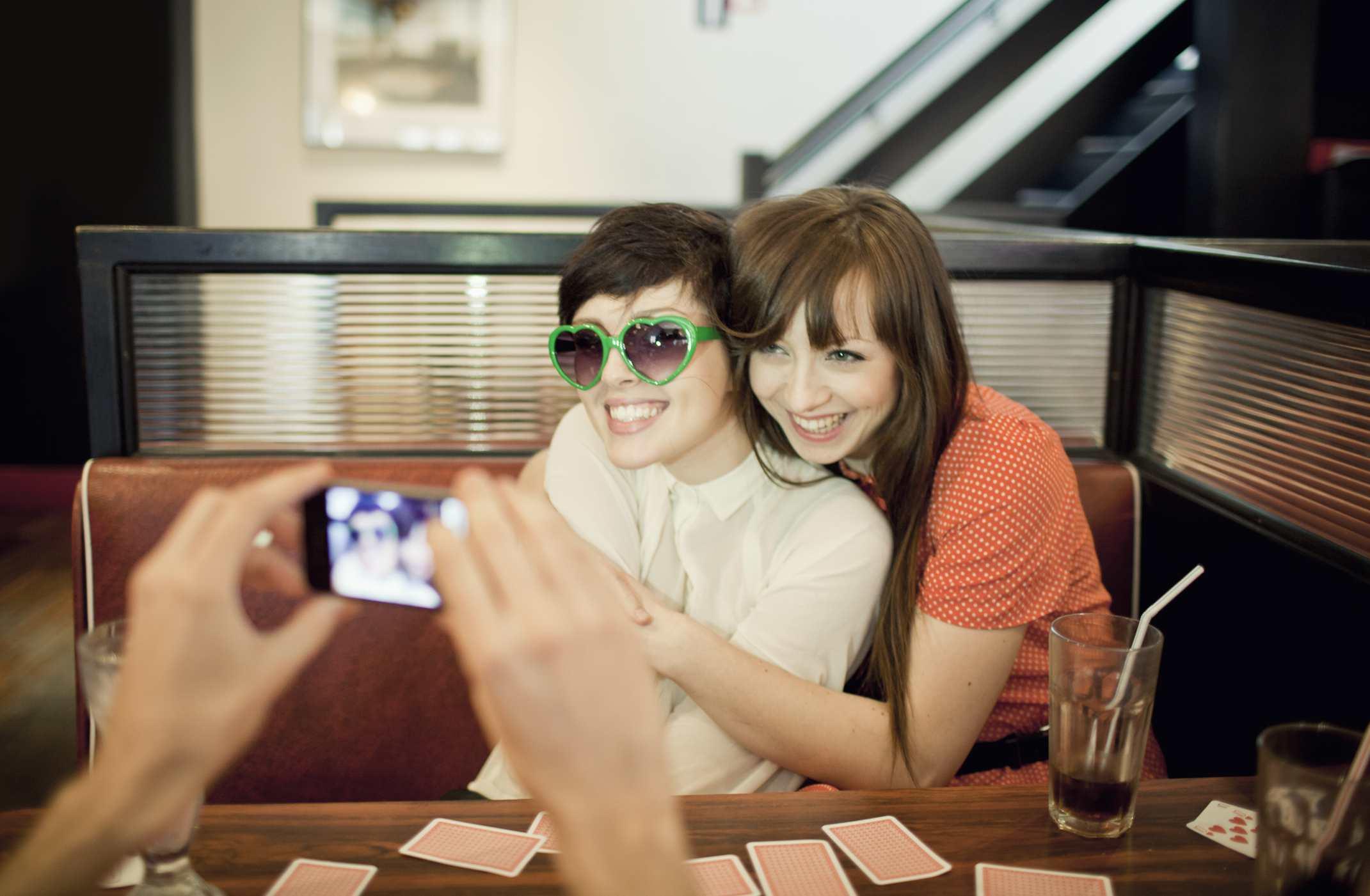 An image of two women having their photo taken.