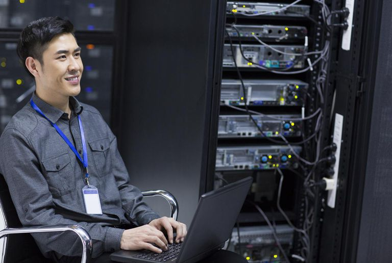 IT associate working on server