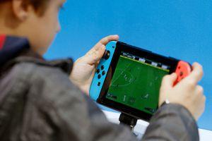 Boy playing Nintendo Switch