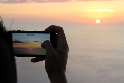 Taking a photo while recording video on iPhone