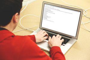 A man installing Homebrew on a Mac Laptop.