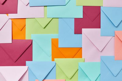 Colorful decorative background from handmade blank envelopes as a pattern.