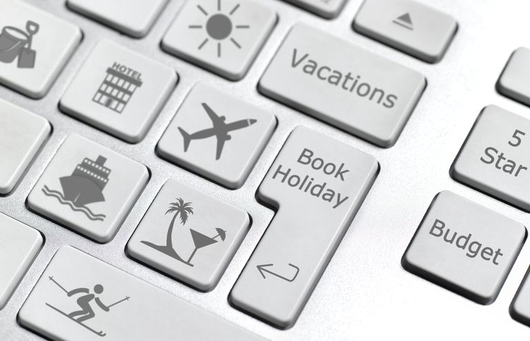 White keyboard with vacation icons