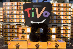TiVo mascot sitting on TiVo boxes