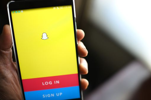 An image of the Snapchat login page on a smartphone.