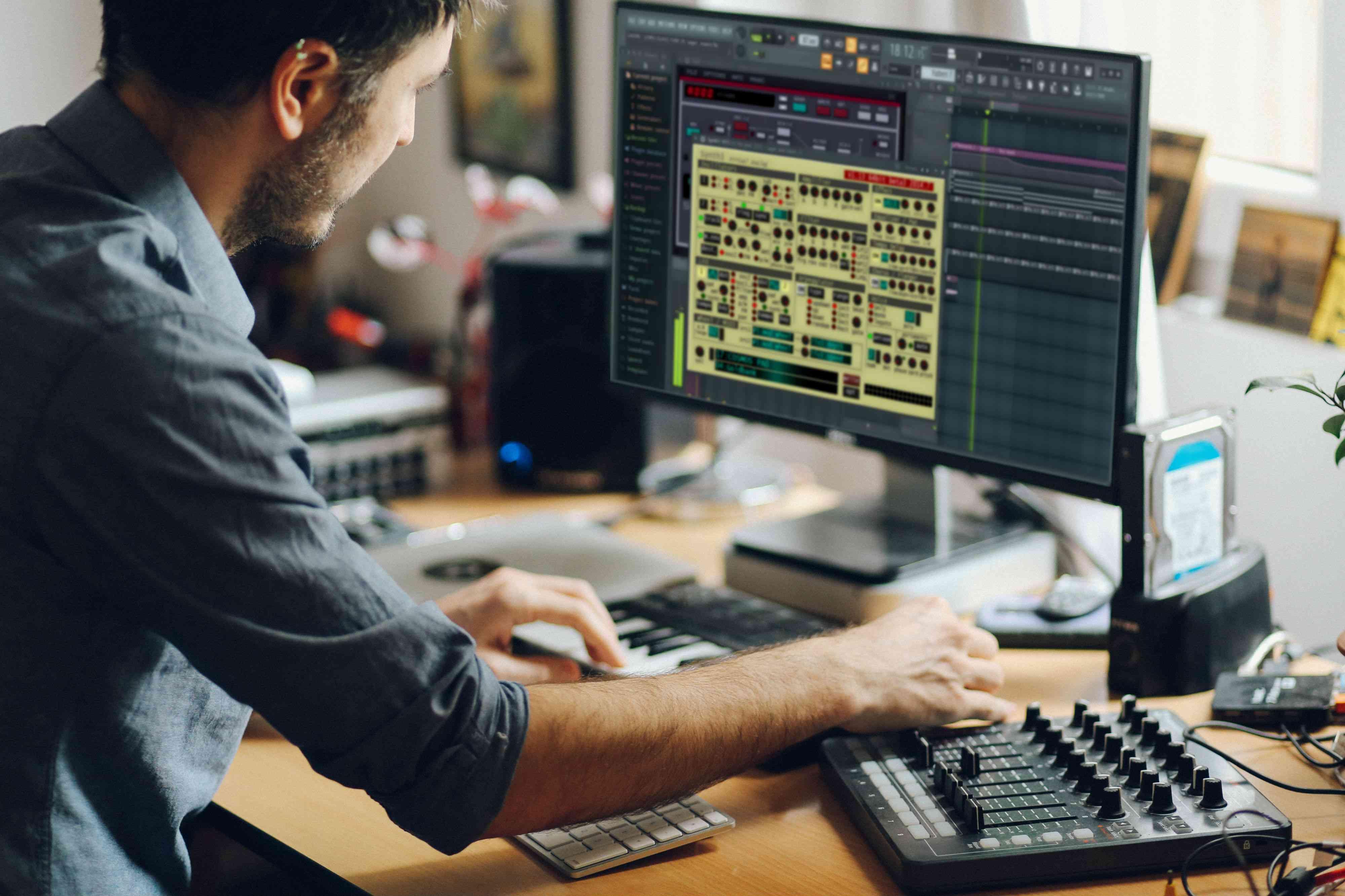 A man using VST plug-in with FL Studio.