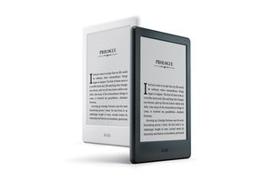 Black and a white Amazon Kindle devices.