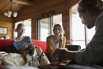 Friends sitting around playing on iPad
