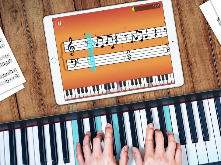Piano Maestro app on an iPad above a piano