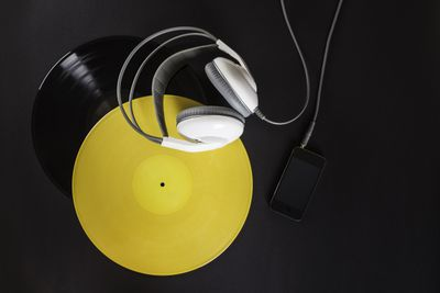 Vinyl record, headphones and mp3 player