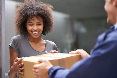 Woman receiving package from Amazon Prime