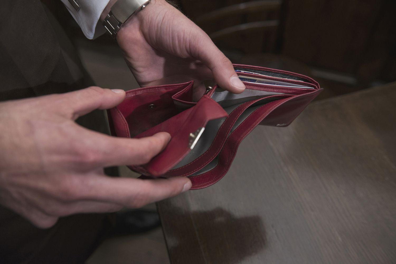 Man's hands holding an Empty wallet