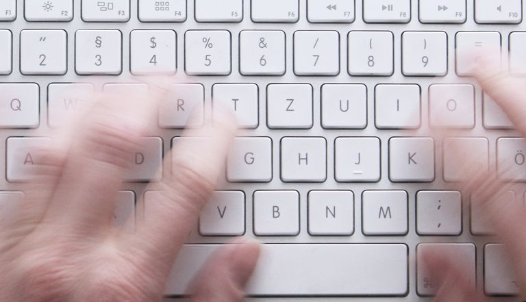 Cropped Hands Using Computer Keyboard.