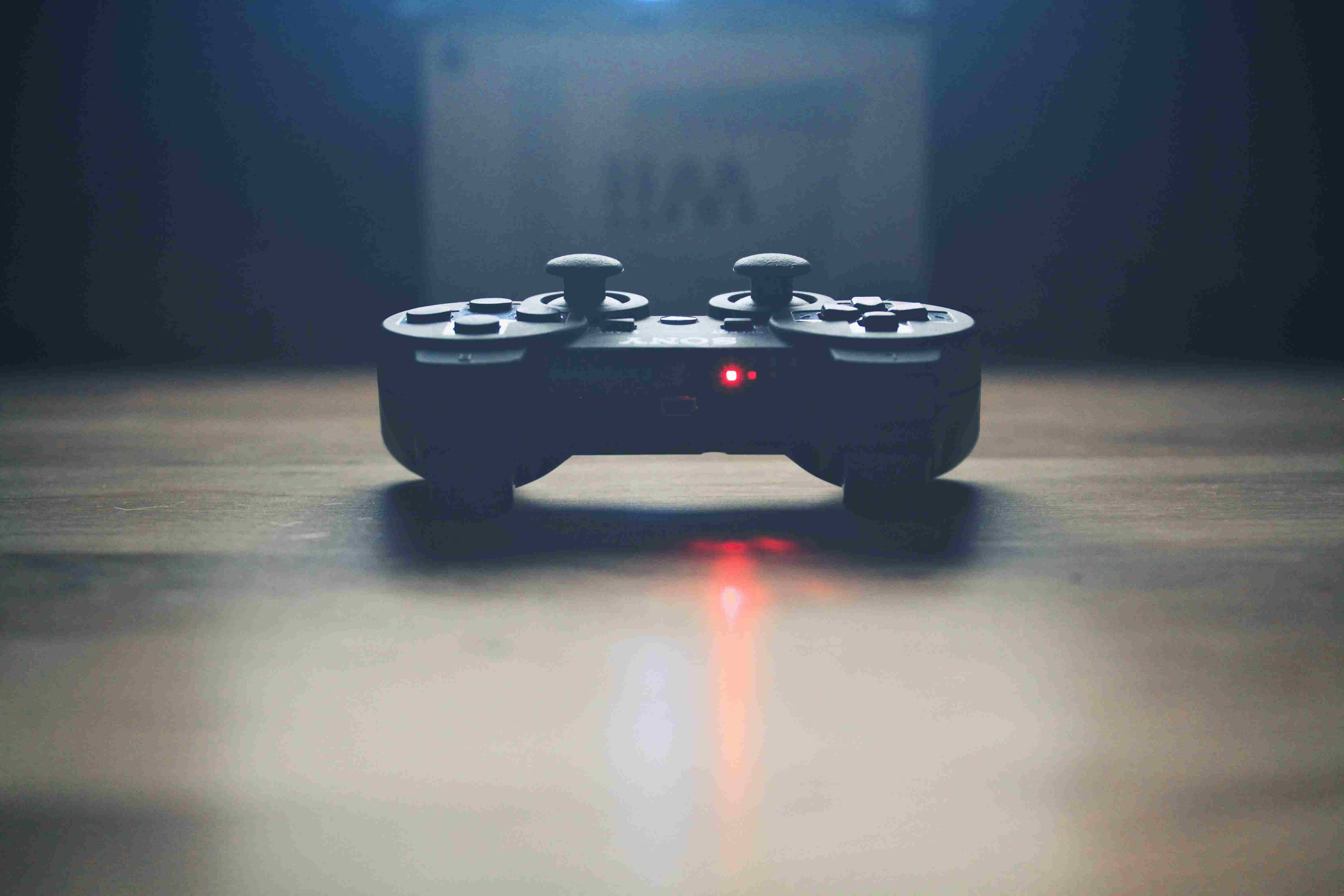 Picture of a video game controller with a red light