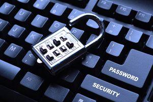 Security lock on black computer keyboard