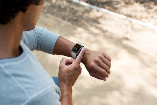 A man checking his heart rhythm with Apple Watch