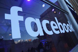 Facebook logo on a glass window