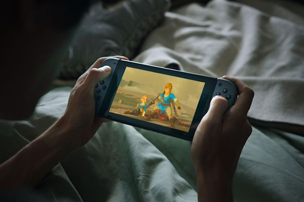 Young boy playing Nintendo Switch