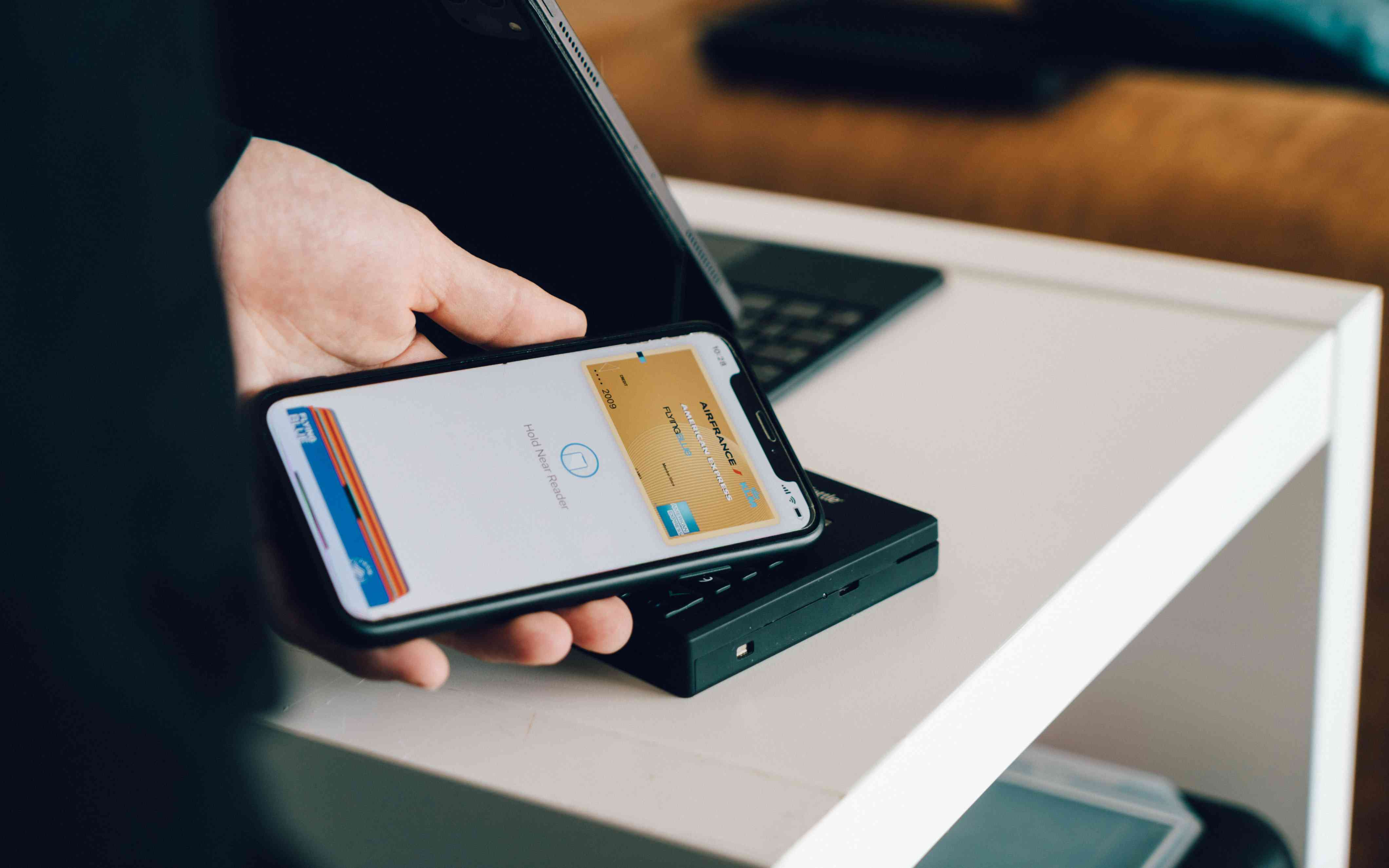 Someone using a smartphone wallet to pay for a purchase.