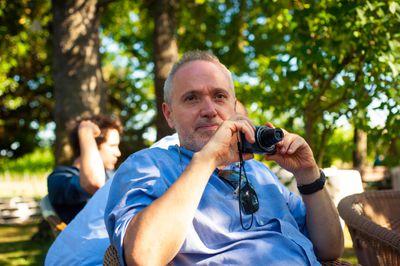 Man holding compact camera