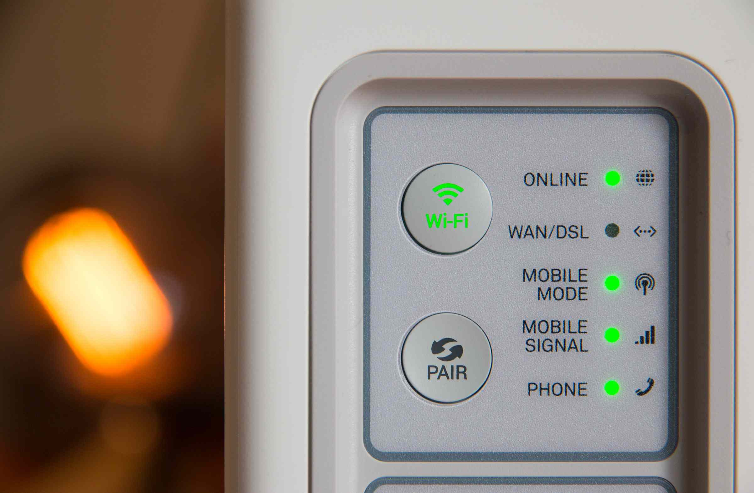 A router showing off its fancy pairing button