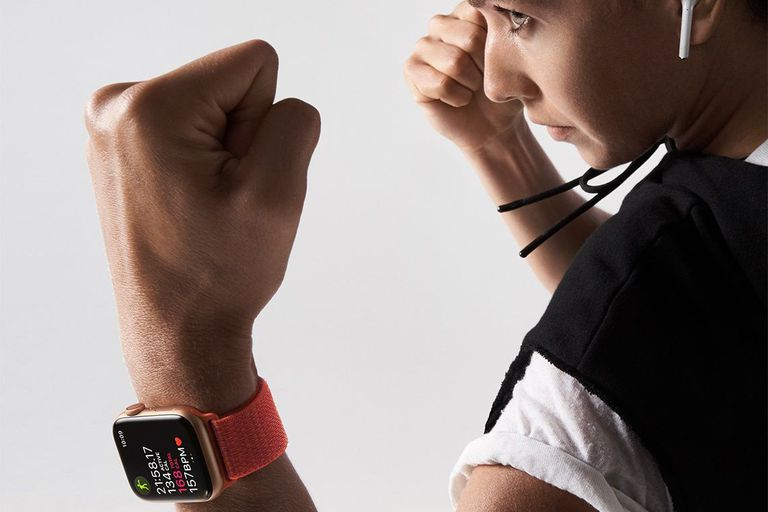 A woman boxer wearing an Apple Watch and AirPods
