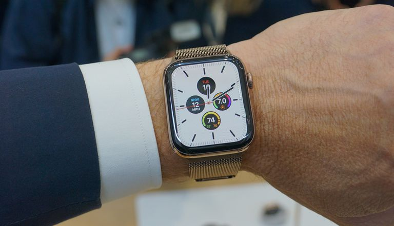 An Apple Watch Series 5 on a man's wrist.