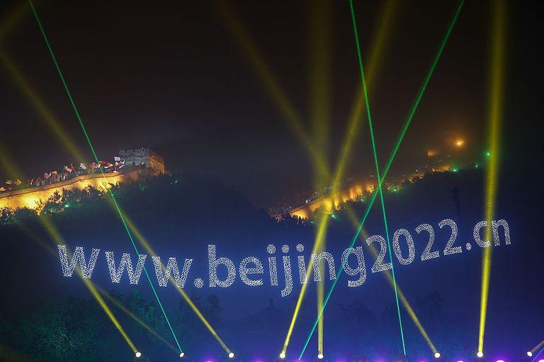 Beijing Winter Olympics words illuminated on Great Wall