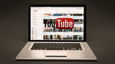 YouTube site and logo on laptop screen