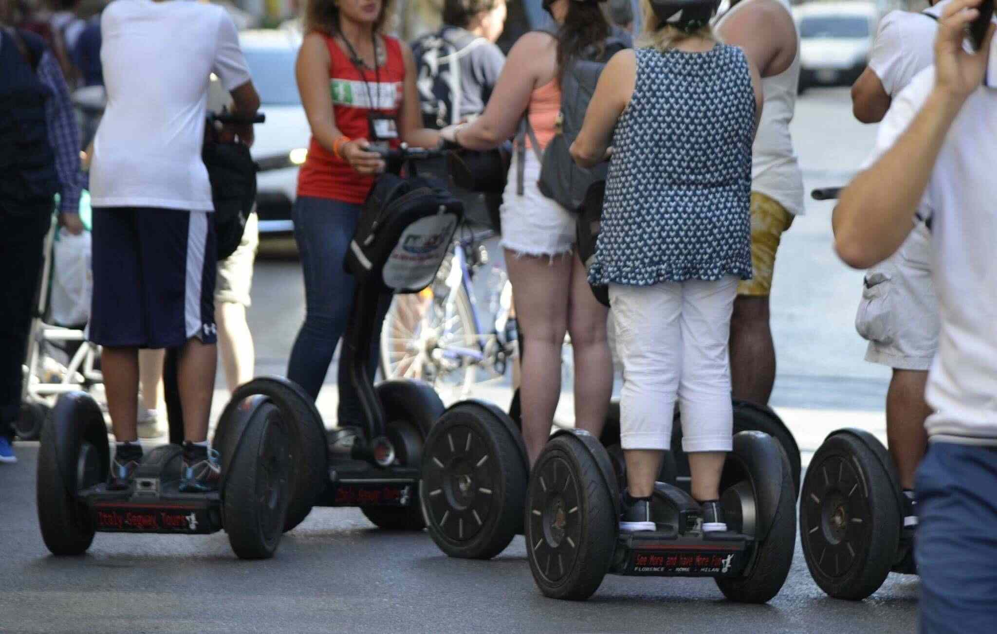 People on Segway scooters