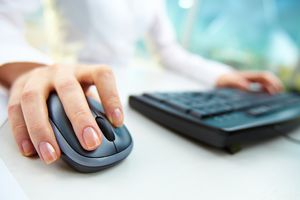 Close up of woman's hand on wireless mouse