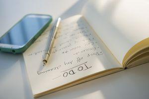 Notebook, to-do list, pen, smartphone
