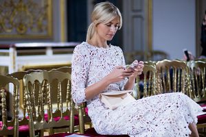 Woman reading on her iphone