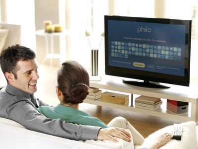A couple watching TV with the Philo app showing on an Amazon Fire TV Stick.