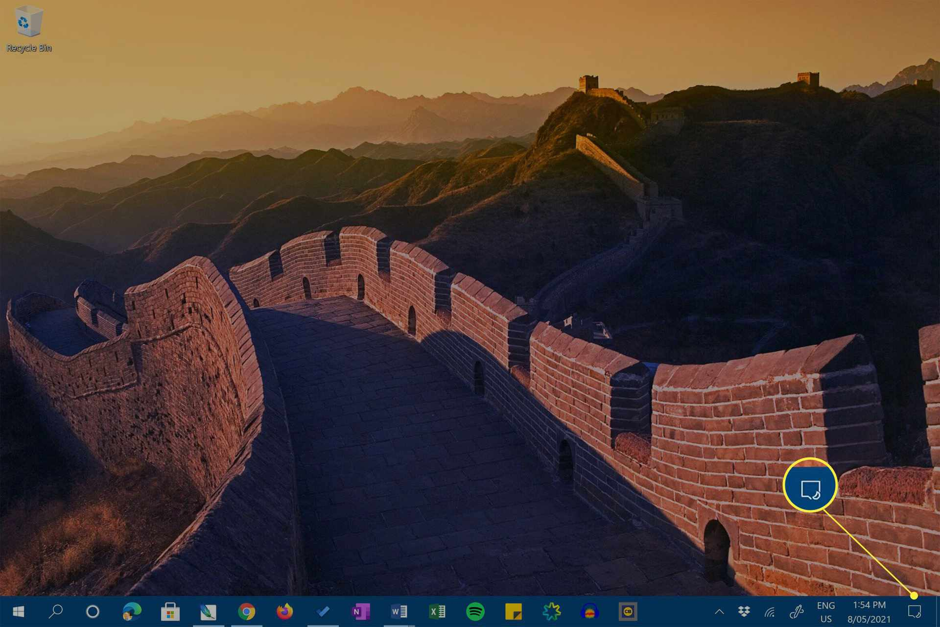 Windows 10 desktop on a Microsoft Surface Pro with Action Center icon highlighted